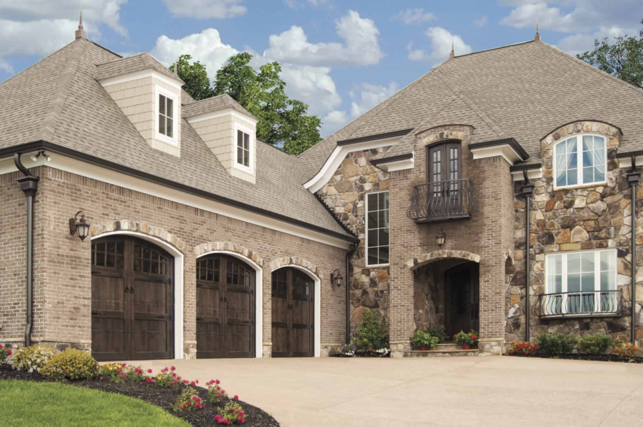 Authentic carriage house style garage doors by wayne for Garage style homes